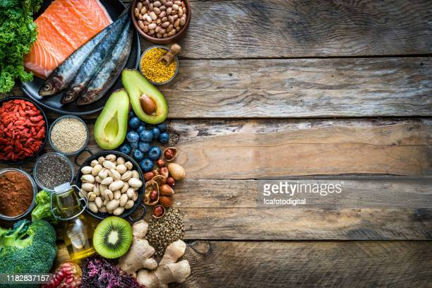 healthy eating: selection of antioxidant group of food frame. copy space - nut food stock pictures, royalty-free photos & images