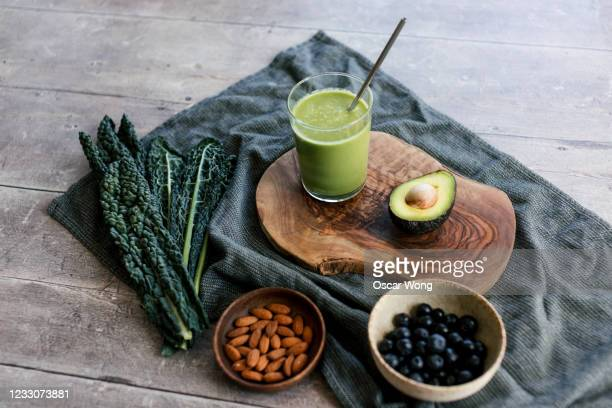 healthy eating with green smoothie - dieting stock pictures, royalty-free photos & images