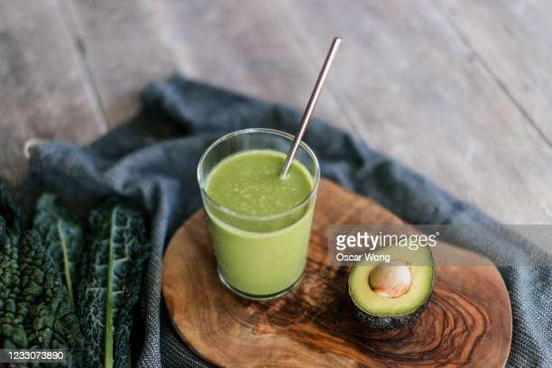 healthy eating with green smoothie - environmental conservation stock pictures, royalty-free photos & images