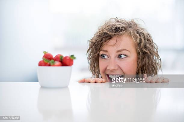 Healthy eating woman craving for strawberries