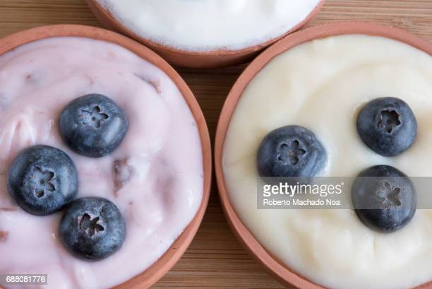Healthy eating yogurt small portions of diverse flavor with blueberries on top Yogurt include having good bacteria offering benefits to the body