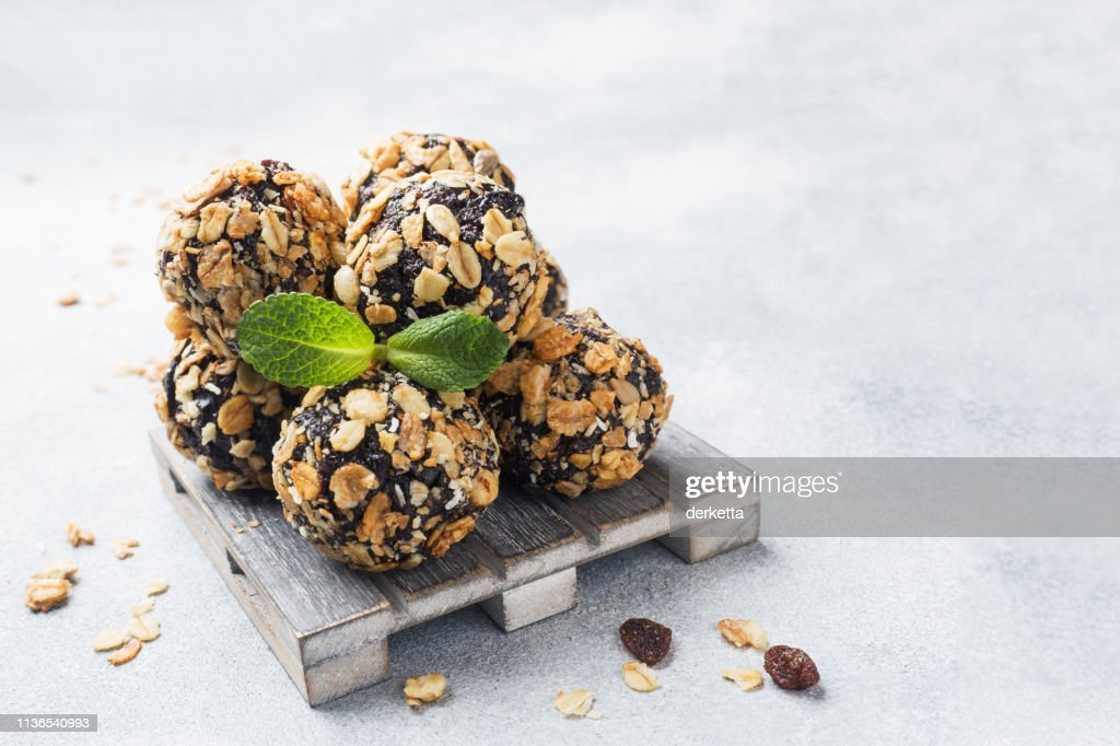 Healthy energy balls made of dried fruits and nuts with oatmeal and muesli . Raw vegan candy. : Stock Photo