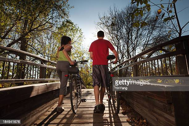 Healthy Exercise Bicyclists Couple in Late Afternoon Sun