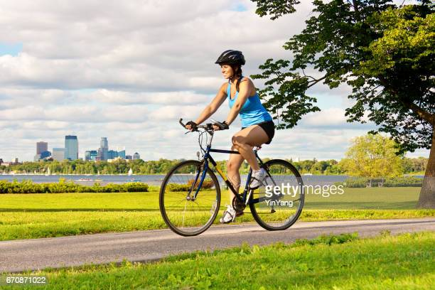 Healthy Exercise Fit Young Woman Bicycling in Urban City Park