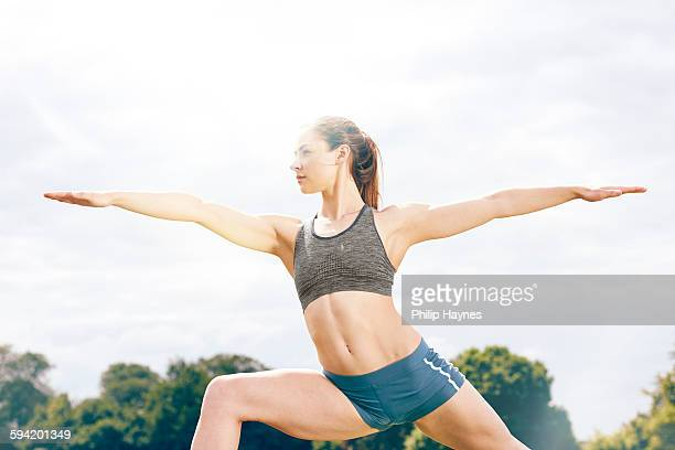 healthy female athlete in deep yoga pose