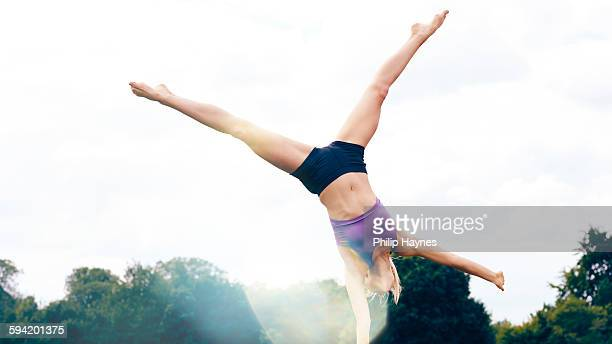 healthy female doing a cartwheel