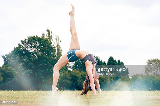 healthy female doing yoga in a field