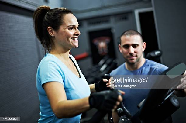 Healthy Female on Cross Trainer in Gym