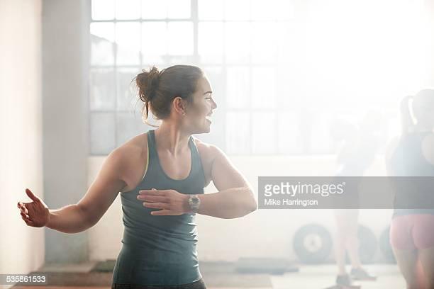 Healthy female warming up in urban gym