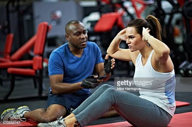 healthy female with fitness instructor. - instructor stock pictures, royalty-free photos & images