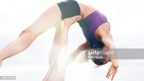 healthy females doing yoga in a field
