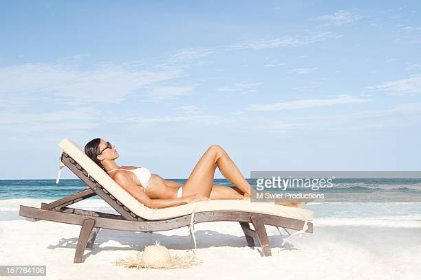 healthy fit woman sunbathing - women sunbathing stock photos and pictures