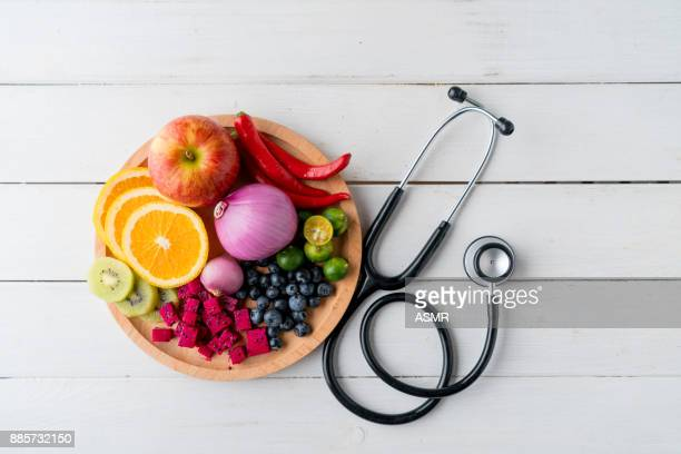 Healthy food in heart dish with doctor's stethoscope