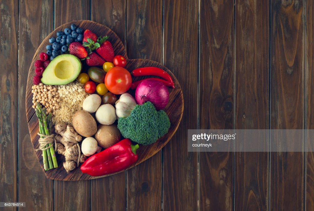 Healthy food on a heart shape cutting board : Stock Photo