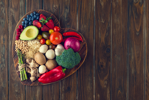 Healthy food on a heart shape cutting board 643764514