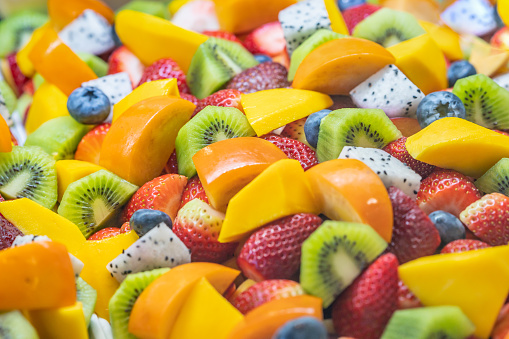 Healthy fresh fruit salad on white background. Top view.Fruit background - gettyimageskorea