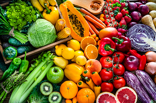 Healthy fresh rainbow colored fruits and vegetables background 1208790371