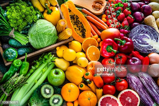 healthy fresh rainbow colored fruits and vegetables background - comida e bebida imagens e fotografias de stock