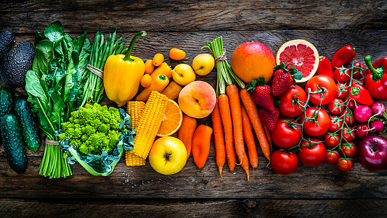 Healthy fresh rainbow colored fruits and vegetables in a row 1208790364
