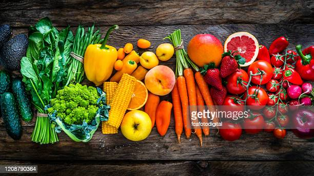healthy fresh rainbow colored fruits and vegetables in a row - fruit stock pictures, royalty-free photos & images
