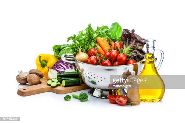 healthy fresh vegetables for preparing salad isolated on white background - cooking utensil stock photos and pictures
