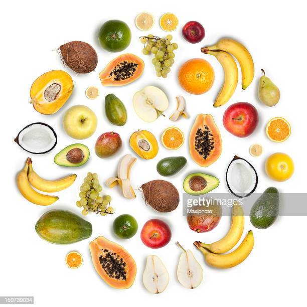 Healthy fruits arranged in a round composition on white background