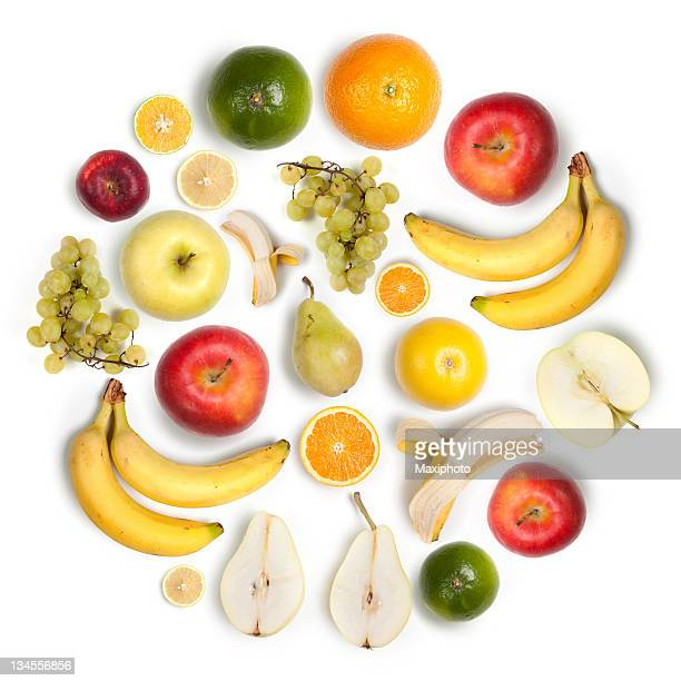 Healthy fruits circular arrangement, white background:  apples, bananas, lemons