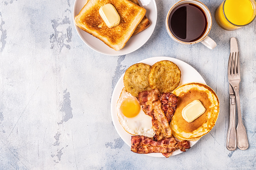Healthy Full American Breakfast with Eggs Bacon Pancakes and Latkes 1126089794