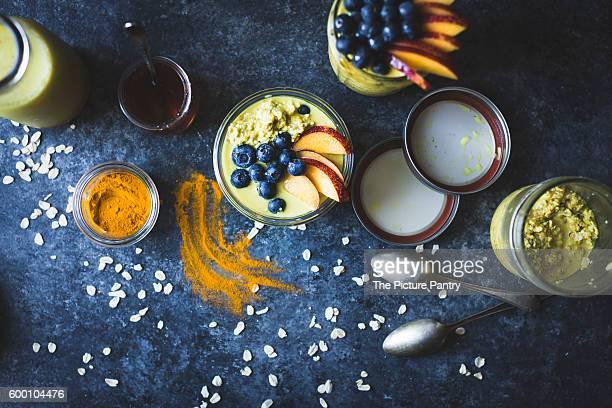 Healthy Golden milk overnight oats for breakfast with fresh fruits {gluten-free)
