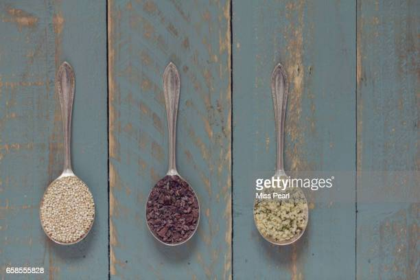 Healthy grains and seeds on spoons
