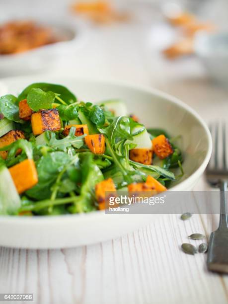 healthy green salad with roasted butternuts squash - roasted stock photos and pictures