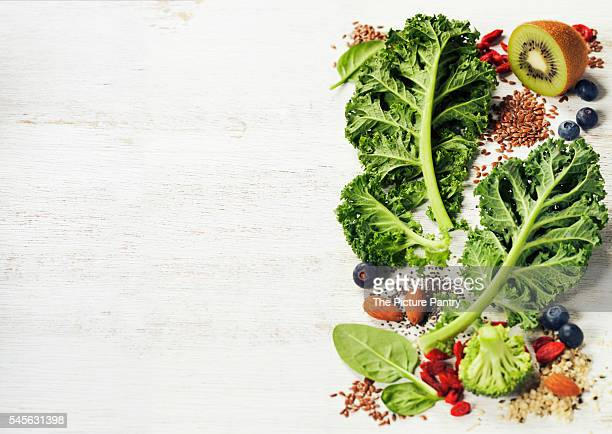 Healthy green smoothie or salad ingredients on white