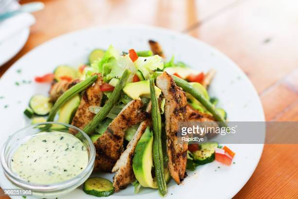 healthy grilled chicken salad - salad dressing stock pictures, royalty-free photos & images