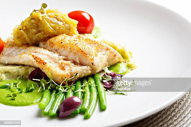 Healthy grilled fish entree with selection of vegetables