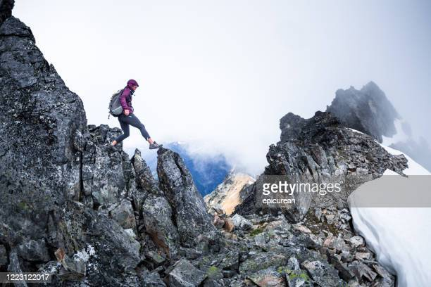 healthy happy woman hiking on a mountain ridge - washington state stock pictures, royalty-free photos & images