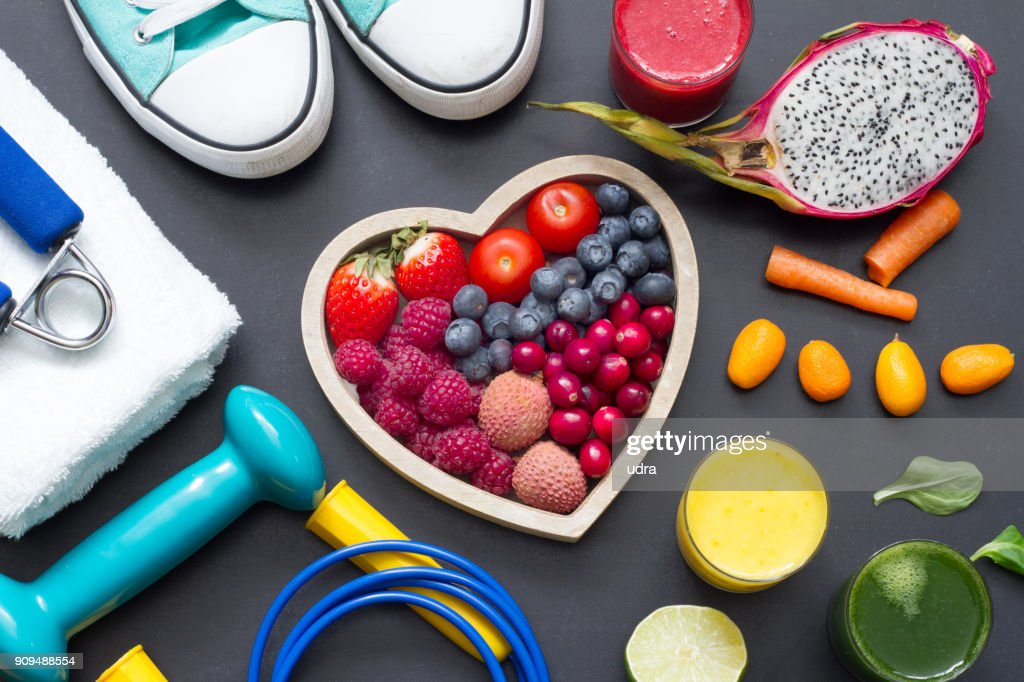 Healthy heart  diet and sport gym equipment concept on blackboard : Stock Photo