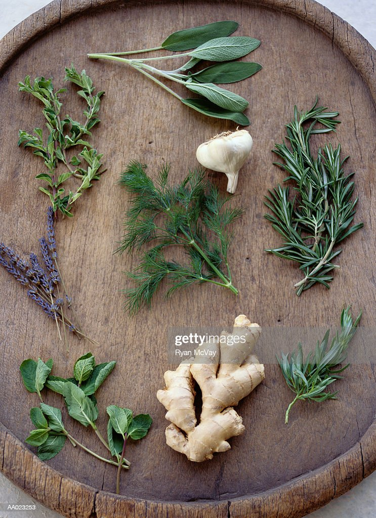 Healthy Herbs, Garlic, and Ginger Root on a Tray : Stock Photo