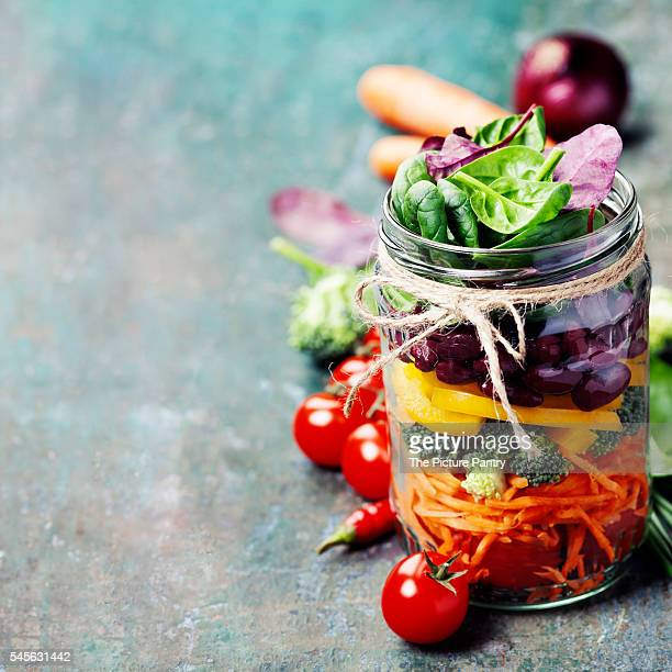 healthy homemade mason jar salad with beans and vegetables - jars with salad stock pictures, royalty-free photos & images