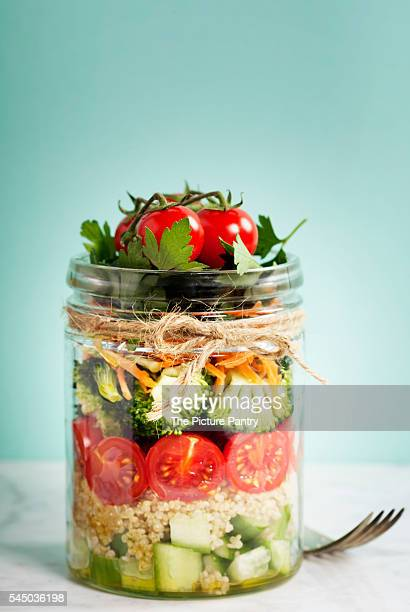 healthy homemade mason jar salad with quinoa and vegetables - jars with salad stock pictures, royalty-free photos & images