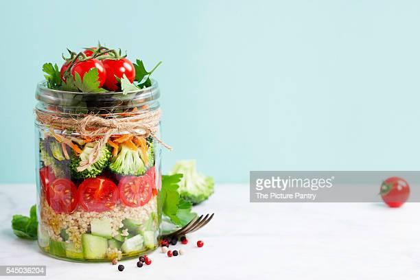 Healthy Homemade Mason Jar Salad with Quinoa and Vegetables