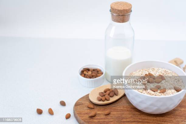 healthy homemade oatmeal breakfast in a bowl close up - quaker stock pictures, royalty-free photos & images