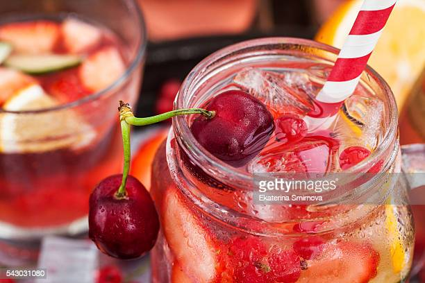 Healthy infused detox water with fresh berries and fruits in mason jar
