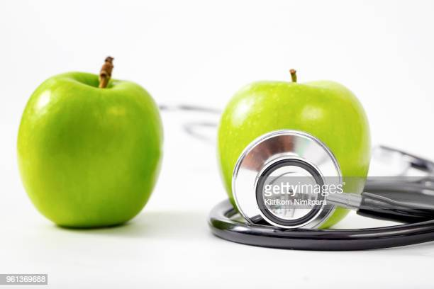Healthy Lifestyle Concept ,Medical stethoscope and apple for diet