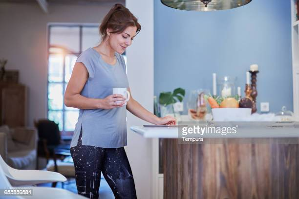 healthy lifestyle in kitchen. - yoga pants stock photos and pictures