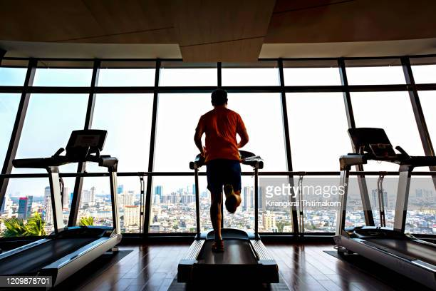 healthy lifestyle: jogging in the gym. - gym stock pictures, royalty-free photos & images