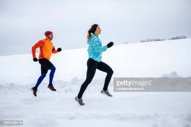 two people running outdoors at winter