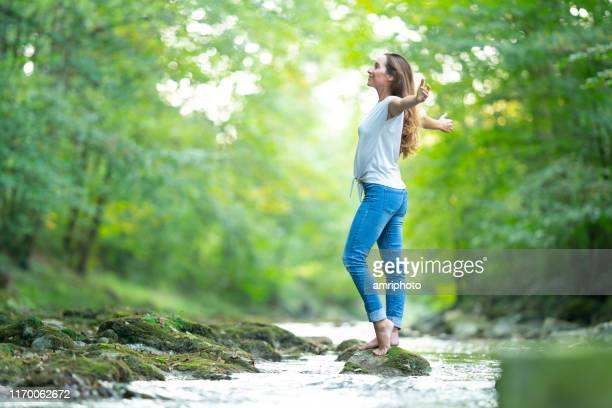 healthy lifestyle woman in close touch with nature - only mid adult women stock pictures, royalty-free photos & images