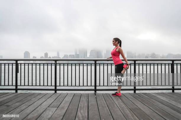 Healthy Lifestyle Young Woman Stretching in New York City