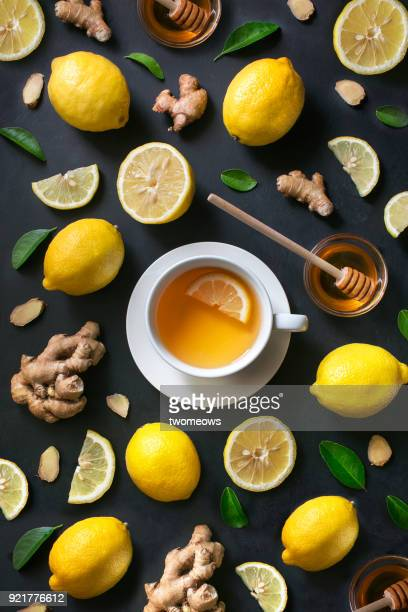 healthy living herbal tea; lemon honey tea with ginger root. - ginger plant stock pictures, royalty-free photos & images