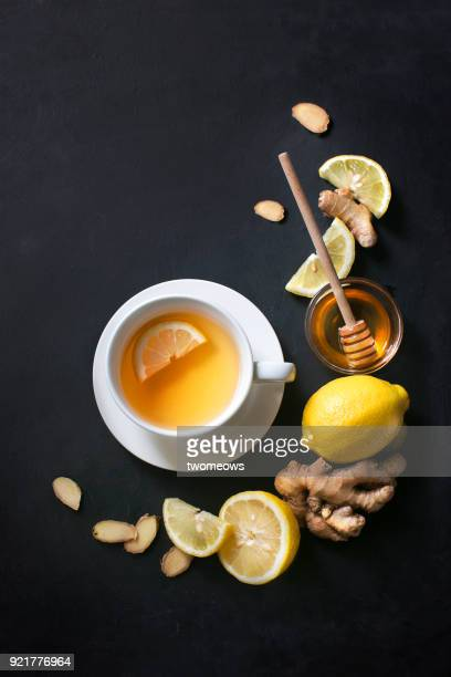 healthy living herbal tea; lemon honey tea with ginger root. - ginger spice stock pictures, royalty-free photos & images